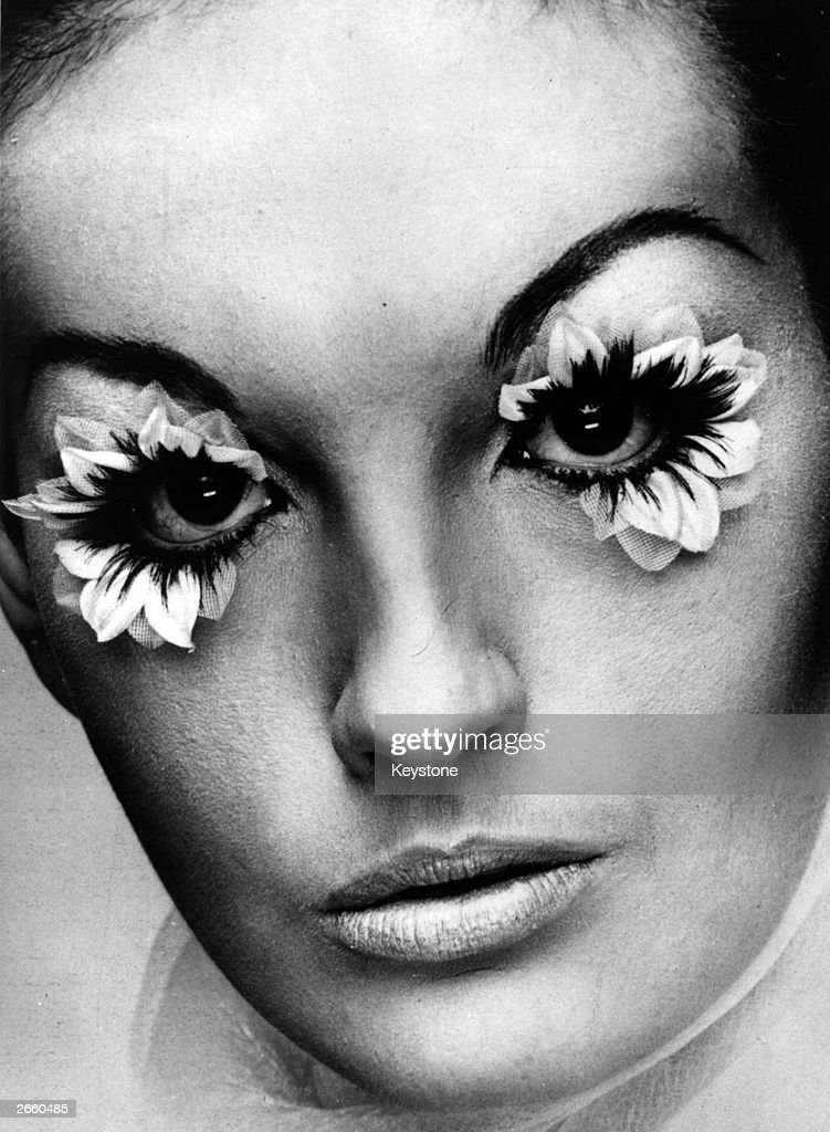 A model wearing false eyelashes, made from fake flower petals and real hair. The lashes, which cost 5 guineas a pair, are produced by Eylure at their London centre in Grosvenor Street.