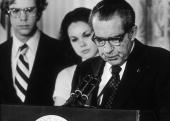 US President Richard Nixon looks down as stands at a podium reading a farewell speech to his staff following his resignation the White House...