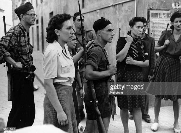 A group of Italian partisans who helped South African troops entering Pistoia in Italy to ferret out German snipers and pockets of resistance