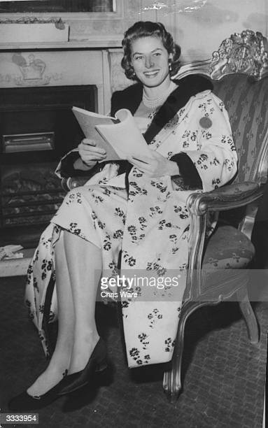 Film star Ingrid Bergman in London to shoot scenes for her film 'Indiscreet' She is wearing and black and white Dior dress and coat while she studies...