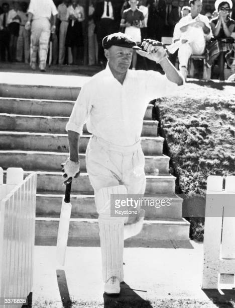 Australian cricketer Don Bradman statistically the greatest batsman ever strolls onto the pitch to bat at Canberra where the MCC are playing the...