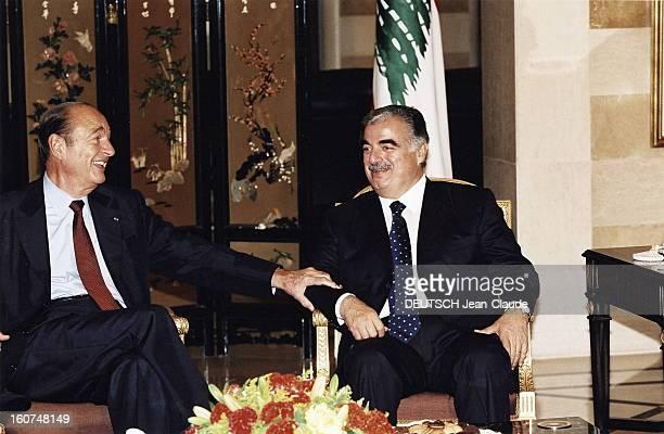 9th Francophonie Summit In Beirut Jacques CHIRAC riant assis aux côtés de Rafic HARIRI au Grand Sérail à BEYROUTH