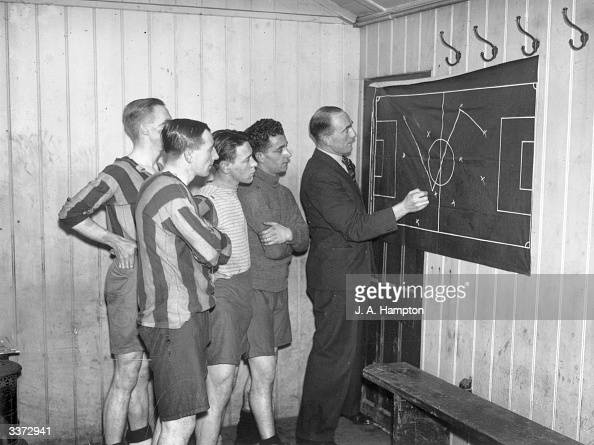 Former Arsenal Captain Tom Parker demonstrating positional play to members of the Nunhead team in the changing room