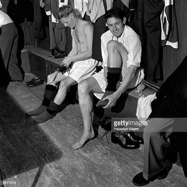 Bristol Rovers players get their kit on in the changing room Original Publication Picture Post 6864 Bristol Rovers No Buy No Sale pub 1954