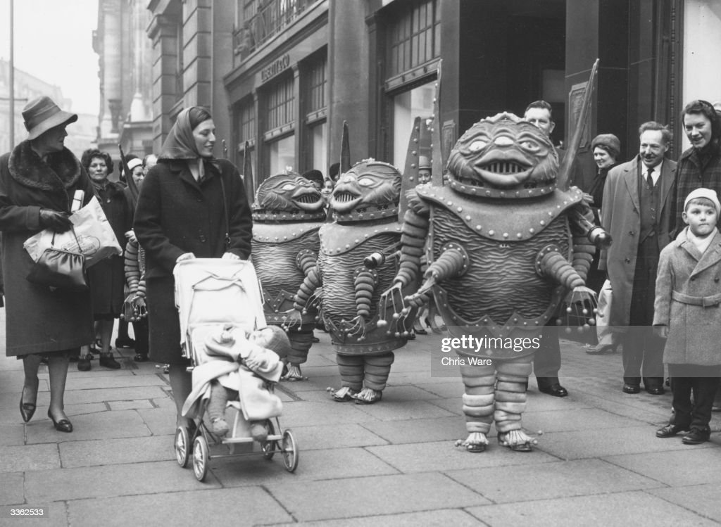 Members of Lester's midgets who play martians in the 'Man In The Moon' with Charlie Drake at the London Palladium taking a break in costume to the...
