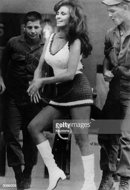 Two GI's admiring the American actress Raquel Welch during a visit to Vietnam