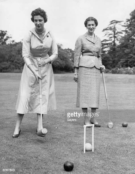 Marina Duchess of Kent playing croquet with her daughter Princess Alexandra on the lawns of 'The Coppice' in Buckinghamshire