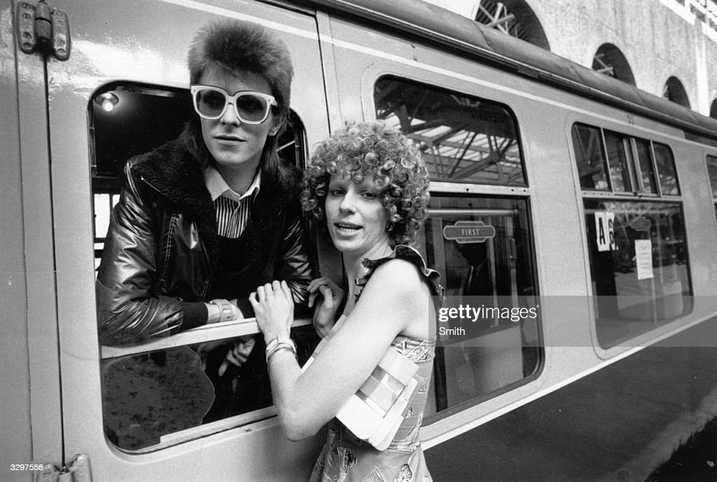 Pop singer <a gi-track='captionPersonalityLinkClicked' href=/galleries/search?phrase=David+Bowie&family=editorial&specificpeople=171314 ng-click='$event.stopPropagation()'>David Bowie</a> is seen off at the station by his wife Angie.