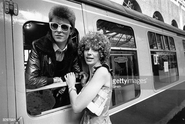 Pop singer David Bowie is seen off at the station by his wife Angie