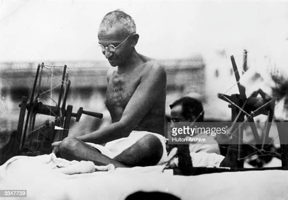 Indian Nationalist leader Mahatma Gandhi at a spinning wheel during a 'Charlea' demonstration in Mirzapur Uttar Pradesh