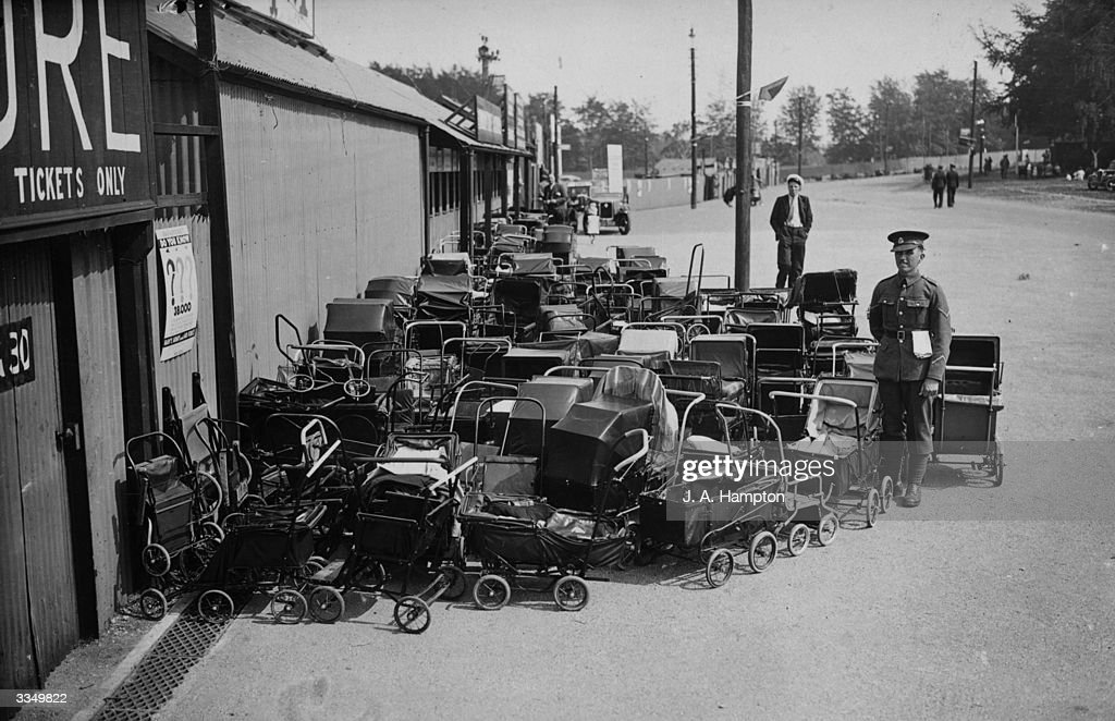 A guard watches over the multitude of prams left outside the Rushmoor Arena at the military base of Aldershot Hampshire while the prams' occupants...
