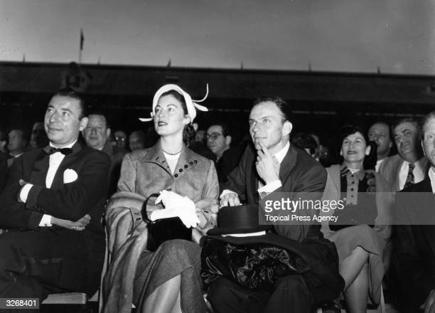 Actress Ava Gardner actor and singer Frank Sinatra and band leader Joe Loss in the front row at White City Stadium to watch Randolph Turpin fight...