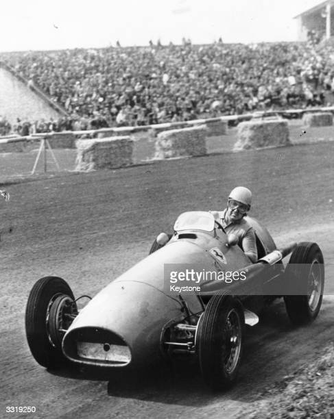 Italian racing driver Alberto Ascari in a Ferrari on his way to winning the Dutch Grand Prix at Zandvoort for the second year running