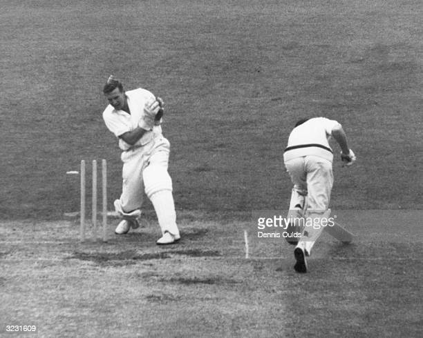 CHECK HIRES IF SUPPLYING DIGITALLY England wicketkeeper Jim Parks whips off the bails as the Australian batsman Bill Lawry is run out for 3 during...
