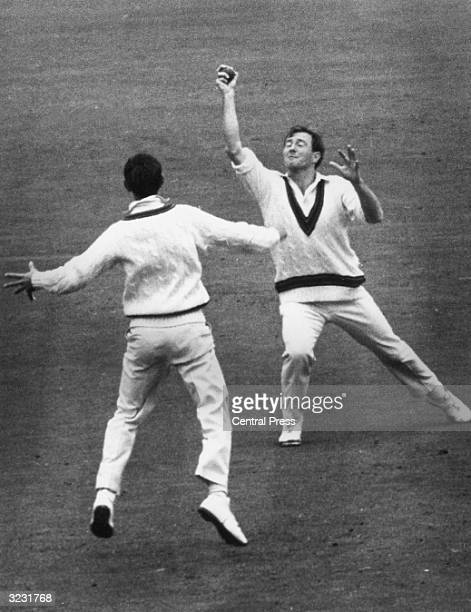 CHECK HIRES IF SUPPLYING DIGITALLY Australia's Ian Redpath looks on as his teammate Graham McKenzie makes a 'blind' catch to dismiss England's Tom...