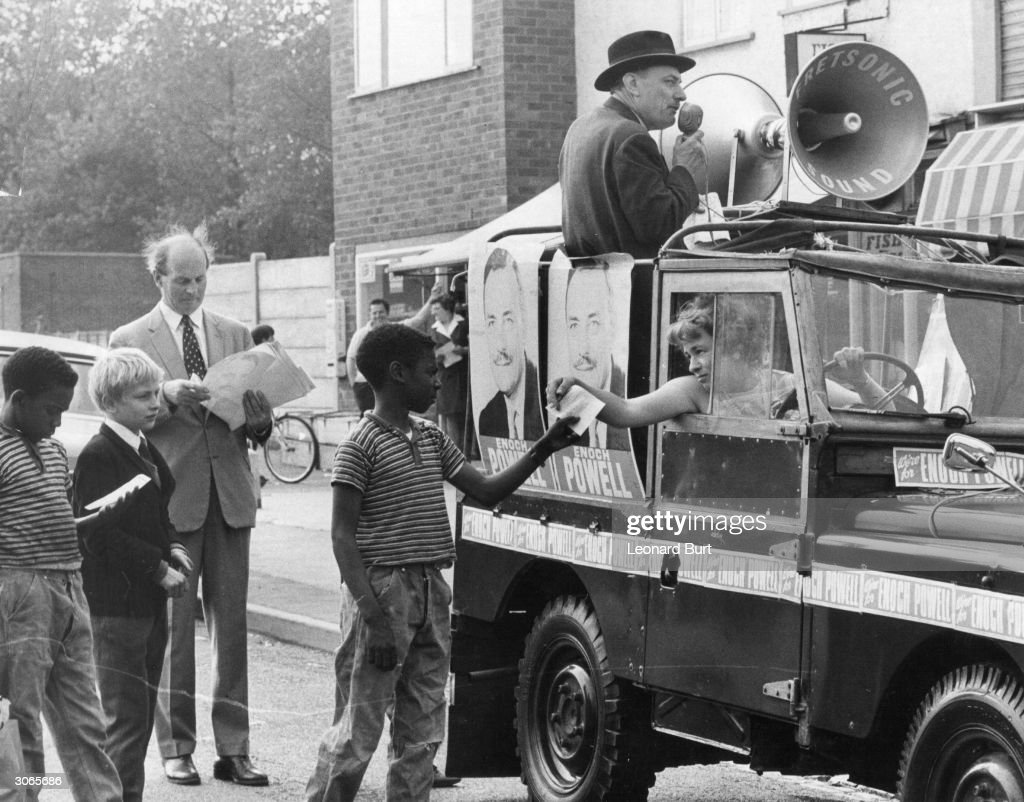 British Conservative politician Enoch Powell electioneering in his Wolverhampton constituency as his wife hands out election literature from their...