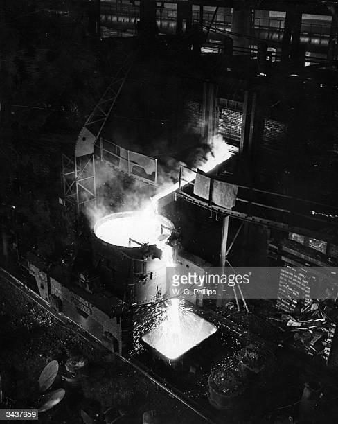 Molten steel flowing from a furnace at the London Midland Scottish works in Crewe