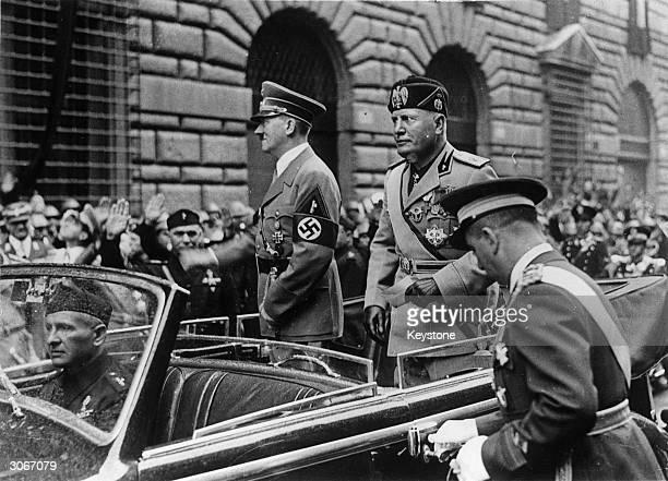 German dictator Adolf Hitler and Italian dictator Benito Mussolini drive through Rome