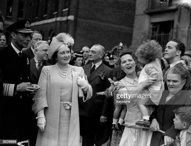 King George VI and Queen Elizabeth during a Royal tour of East London