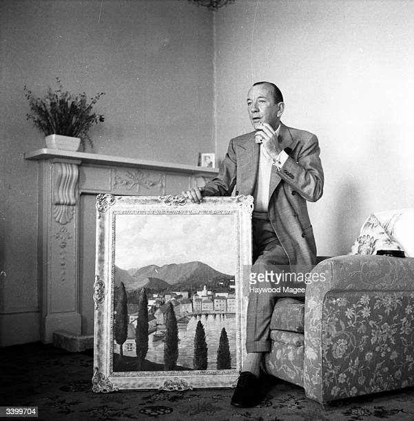 English actor and playwright SIr Noel Coward with one of his paintings He and other amateur artists will be exhibiting works at London's Trafford...