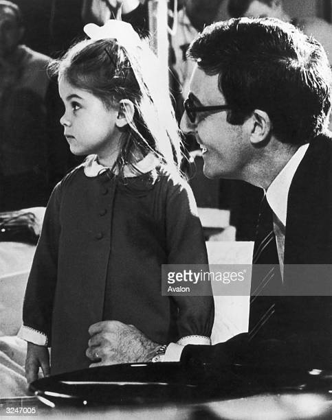 British actor and comedian Peter Sellers takes his daughter Victoria to visit the Hollywood set of his latest film 'I Love You Alice B Toklas'