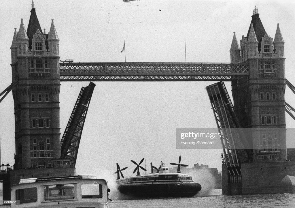 The 'Princess Margaret' hovercraft travelling under Tower Bridge London