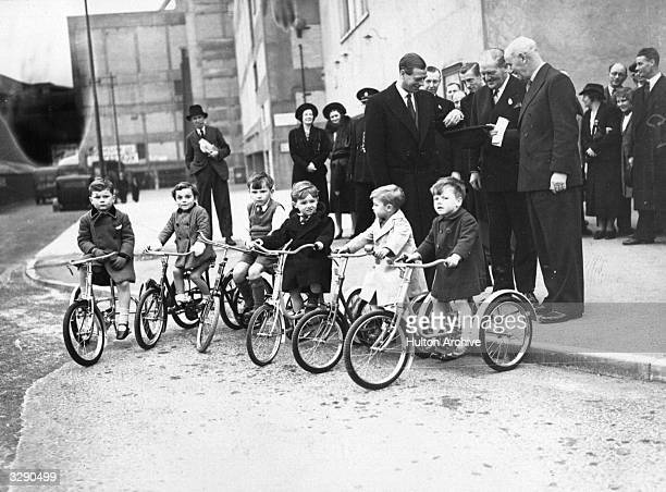 George Edward Alexander Edmund Duke of Kent at the International Bicycle and MotorCycle Show at Earls Court chooses a tricycle for his son Prince...