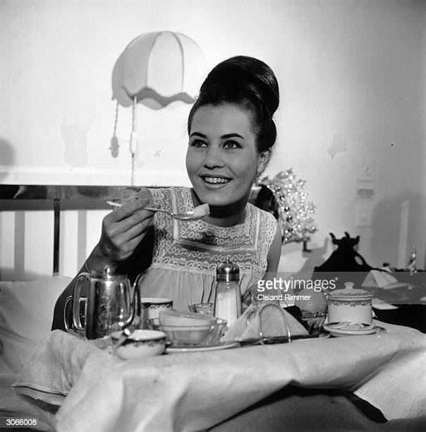 Caterina Lodders Miss World 1962 enjoys breakfast in bed
