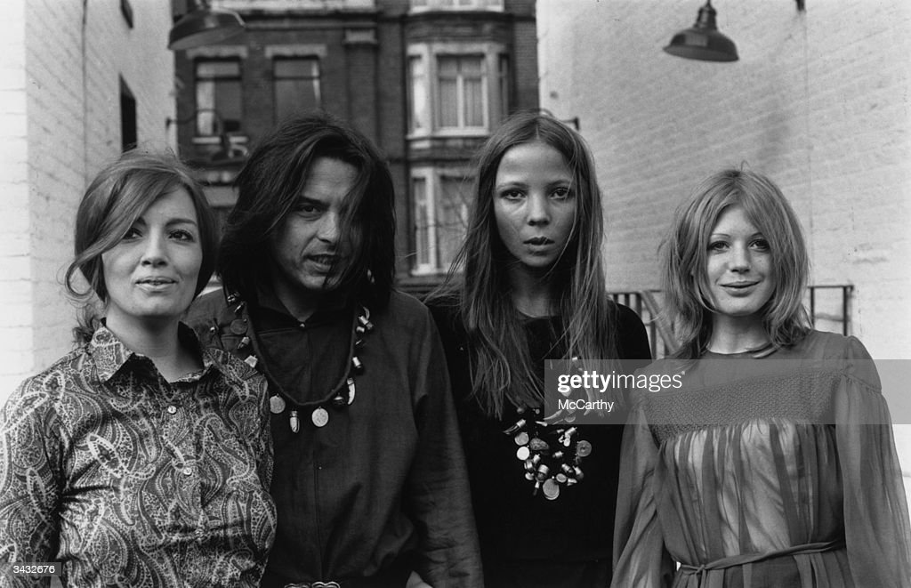 British photographer David Bailey poses for a photocall to advertise the publication of his book 'Goodbye Baby & Amen', a visual chronicle of the 1960's. With him are (left to right) Christine Keeler, Penelope Tree and singer Marianne Faithfull.