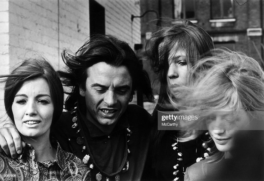 British photographer David Bailey with (from left) Christine Keeler, Penelope Tree and Marianne Faithfull at a photocall for the publication of one of Bailey's books.