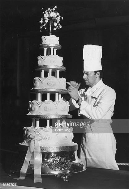 Sergeant Major David Dodd of the Army Catering Corps putting the finishing touches to the wedding cake for the wedding of Princess Anne and Captain...