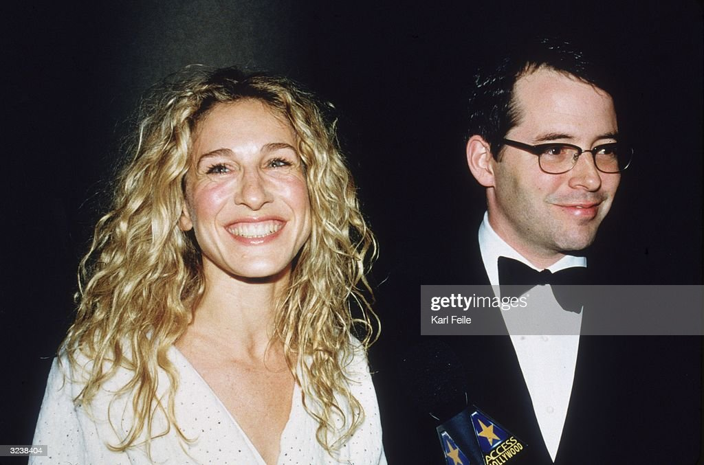 Married American actors <a gi-track='captionPersonalityLinkClicked' href=/galleries/search?phrase=Sarah+Jessica+Parker&family=editorial&specificpeople=201693 ng-click='$event.stopPropagation()'>Sarah Jessica Parker</a> and Matthew Broderick smiling while standing in front of a handheld 'Access Hollywood' microphone at the For All Kids Foundation's Second Annual White Rose Awards Gala at the Marriott Marquis in Times Square, New York City.
