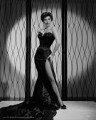 American actress Ava Gardner wearing a fulllength strapless gown with a slit up one side