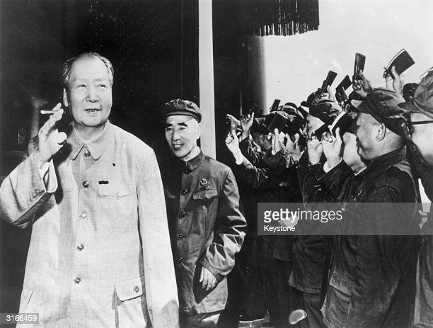 Chairman Mao Zedong together with Vice Chairman Lin Biao acknowledges the waving of 'little red books' on the twentyfirst anniversary of the People's...