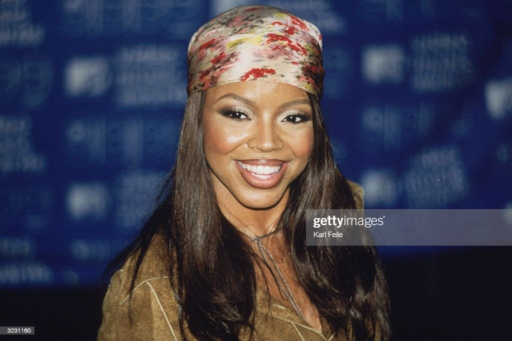 Pop star Shanice smiles at the camera, wearing a multi-colored bandana on her head at the MTV Video Music Awards at the Metropolitan Opera House at Lincoln Center, New York City.