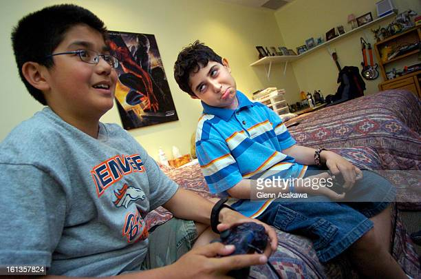 FEARSENDENVER COLORADOMAY 23 2007 9yearold Arsen Mkrtchyan <cq> right makes a 'puppy dog face' to 12yearold brother Hrach <cq> while begging for...