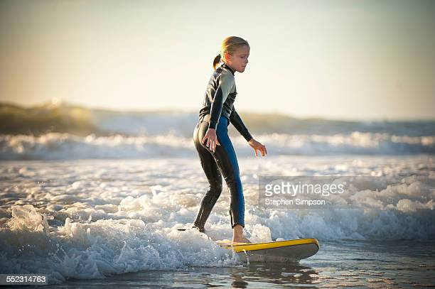 9-year-old girl surfing