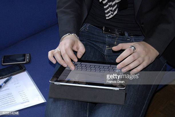 DENMARK _Business woman using apple ipad or galaxy note andusing smart phones too 13 April 2012