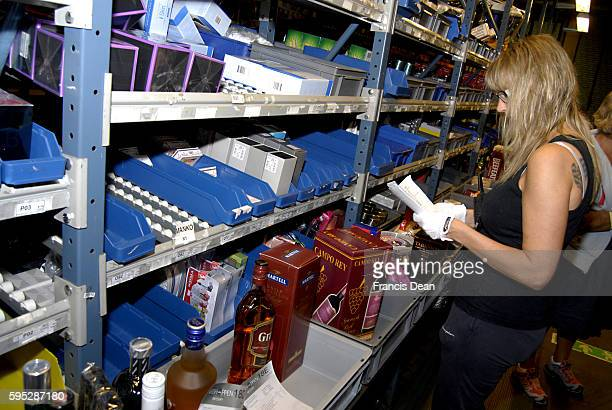 SWEDEN / LUND _Thomas Cook worker packing tax free or duty free goods in airshop platic bags these tax free bags transport to finlandnorwaysweden...