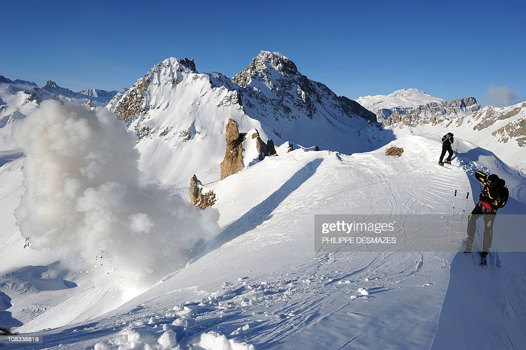 a 25 kg dynamite stick thrown by a member of the ski patrol and bomb expert blasts on January 19 2011 in Tignes eastern France as part of an...