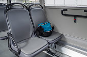 a bag on the seat in bus, nobody