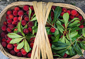 a bamboo basket of waxberries for sale