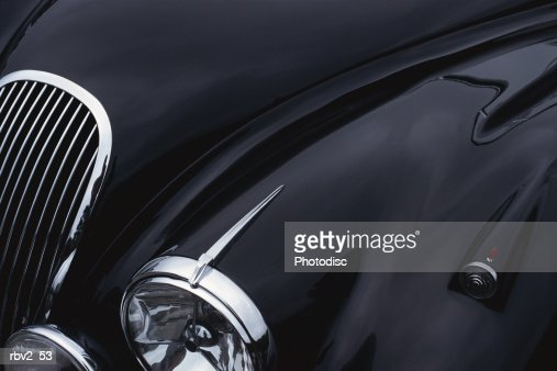 a black jaguar sports car hood showing a grill and headlight : Stock Photo