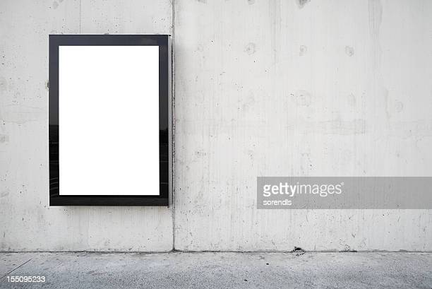 a blank billboard on a wall.