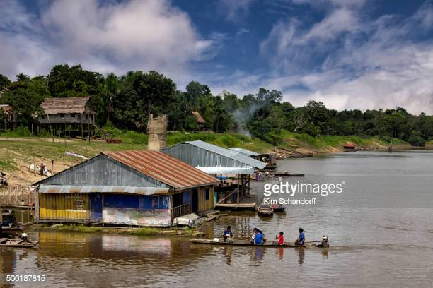 CONTENT] a boat arriving at a small port along the Amazon river in Peru with the jungle in the background