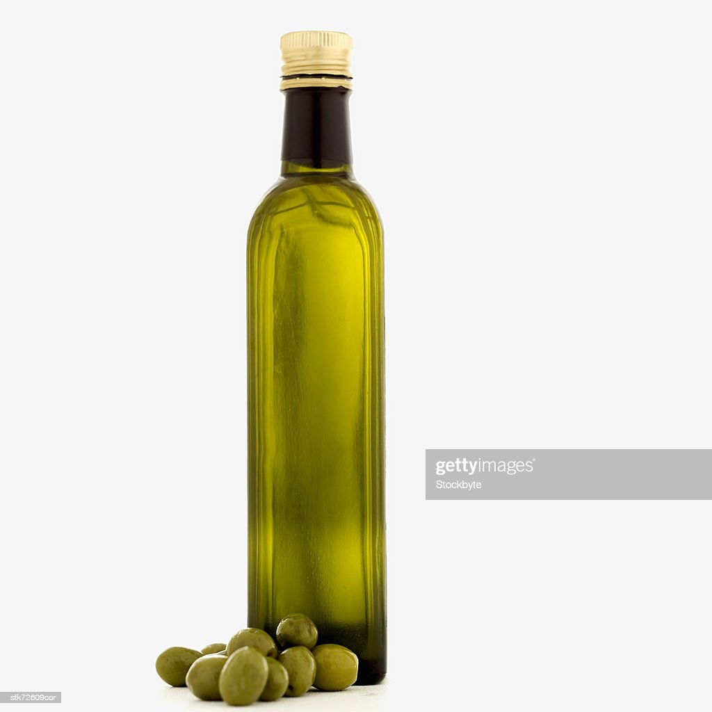 a bottle of olive oil and olives : Stock Photo