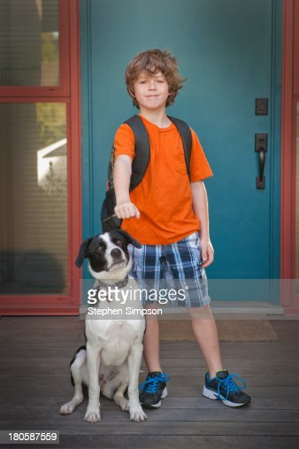 a boy and his dog, going to school : Stock Photo