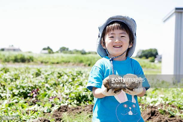 a boy doing farm work