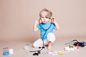 a boy plays in doctor medicine hospital 23
