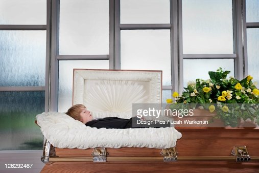 a boy's body laying in a coffin